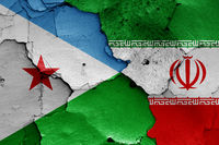 flags of Djibouti and Iran painted on cracked wall