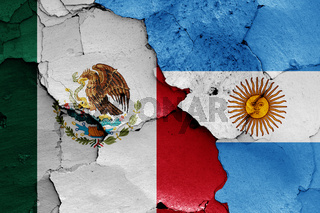 flags of Mexico and Argentina painted on cracked wall