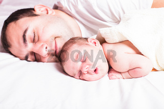 Baby sleeps with dad