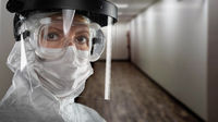 Banner of Female Doctor or Nurse In Medical Face Mask Shield and Protective Gear In Hospital Hallway