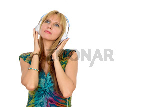 Portrait of beautiful blonde woman thinking and listening to music