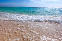 Sand beach and sea waves
