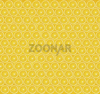 Texture of sliced orange slices on yellow background. Healthy lifestyle