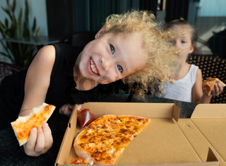 Funny kids eating pizza