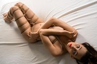 Alluring naked woman tied with ropes