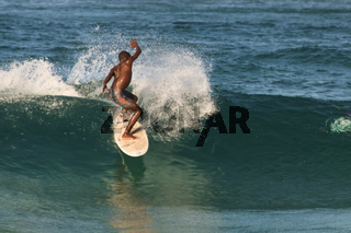 native black african surfer catching a wave