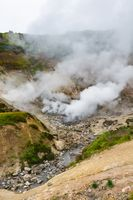Exciting view of volcanic landscape, eruption fumarole, aggressive hot spring, gas-steam activity in crater of active volcano
