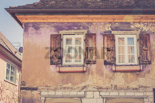 Old residential house facade with windows