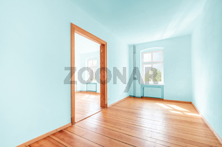 empty room in renovated  flat with green painted walls