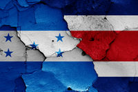 flags of Honduras and Costa Rica painted on cracked wall