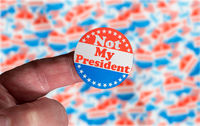 Campaign sticker on finger saying Not my President in dispute over the legal ballot voting