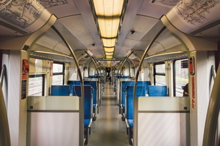 Inside The Wagon Train Germany, Dusseldorf. Empty train interior. interior view of corridor inside passenger trains with blue fabric seats of German railway train system