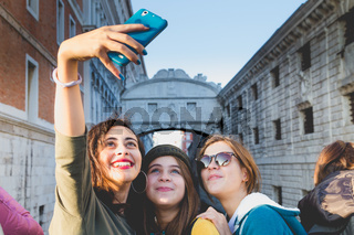 Girls making a selfie in Venice