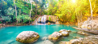 Panorama of beautiful waterfall in wild rainforest in Erawan National park, Thailand