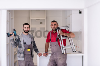 young workers installing a new kitchen