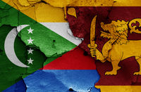 flags of Comoros and Sri Lanka painted on cracked wall
