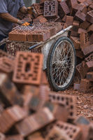 Loading bricks to trolley on the building site