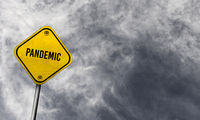 Yellow pandemic sign with cloudy background