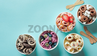 rolled ice creams in cone cups on blue background