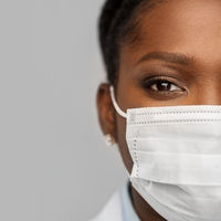 african american female doctor in facial mask