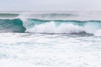 Ocean coast, moviment waves with foam.