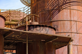 Corroded and rusty gears, tanks and pipes
