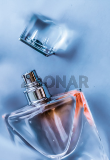 Perfume bottle under blue water, fresh sea coastal scent as glamour fragrance and eau de parfum product as holiday gift, luxury beauty spa brand present