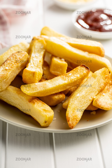 Big french fries. Fried potato chips.