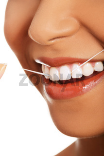 Attractive woman with dental floss. Closeup.