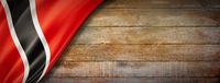 Trinidad And Tobago flag on vintage wood wall banner