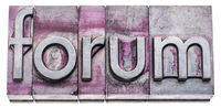 forum word abstract in gritty letterpress metal types