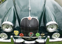 A close up of the bonnet and grille of a vintage jaguar XK 150 british automobile at hebden bridge annual vintage weekend