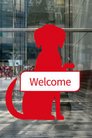 Dogs Welcome sign outside shop