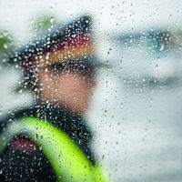 policewoman on traffic security in rainy weather