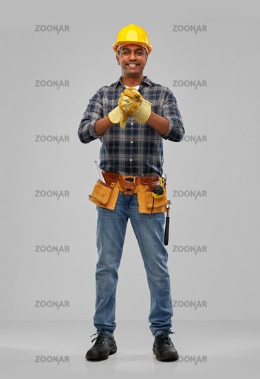 indian worker or builder in helmet and gloves