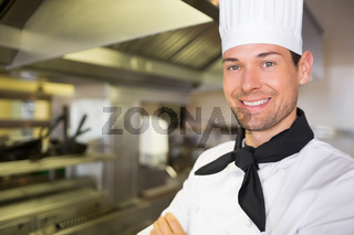 Smiling male cook in the kitchen