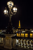 Eiffel tower from the promenade of the Seine at night .