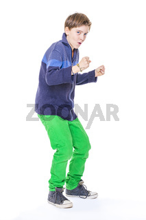 casual cool teenage boy clenches his fists, isolated on white