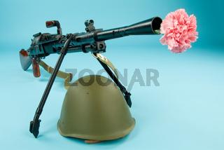 Machine Gun, Flowers And Helmet