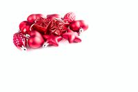 Red Christmas holiday decorations with copyspace