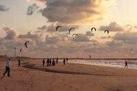 Kite surfing in the sunset at the beach of Scheveningen, the Ne