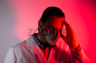 Medical doctor wearing a respiratory mask. Red light emergency and medicine crisis concept.