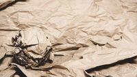 Paper ball among scraps of paper. Idea - comfort zone