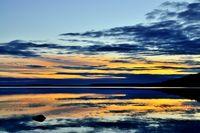 Fabulous mirror sunset. Lake Keret, Northern Karelia, Russia