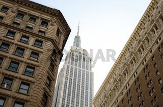Empire State Building between buildings