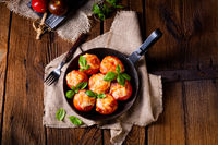 Stuffed tomatoes with minced meat and cheese