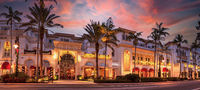 Christmas lights as sunrises over The French restaurant along 5th Street in Old Naples, Florida.