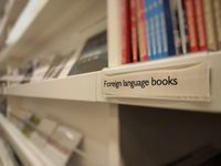 Books on shelf in store labeld with foreign language books