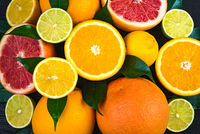 mountain of oranges, grapefruits, limes and lemons. view from above.