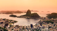 Rio de Janeiro, Brazil. Suggar Loaf and Botafogo beach viewed from Corcovado at sunset